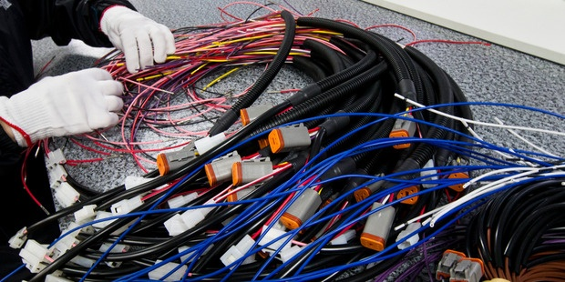 Process workers making wiring looms at Fero in Mount Wellington. Photo / Jason Oxenham